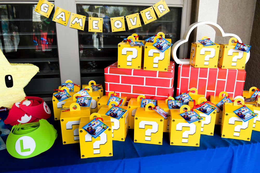 Super Mario Themed party favor boxes sitting on table
