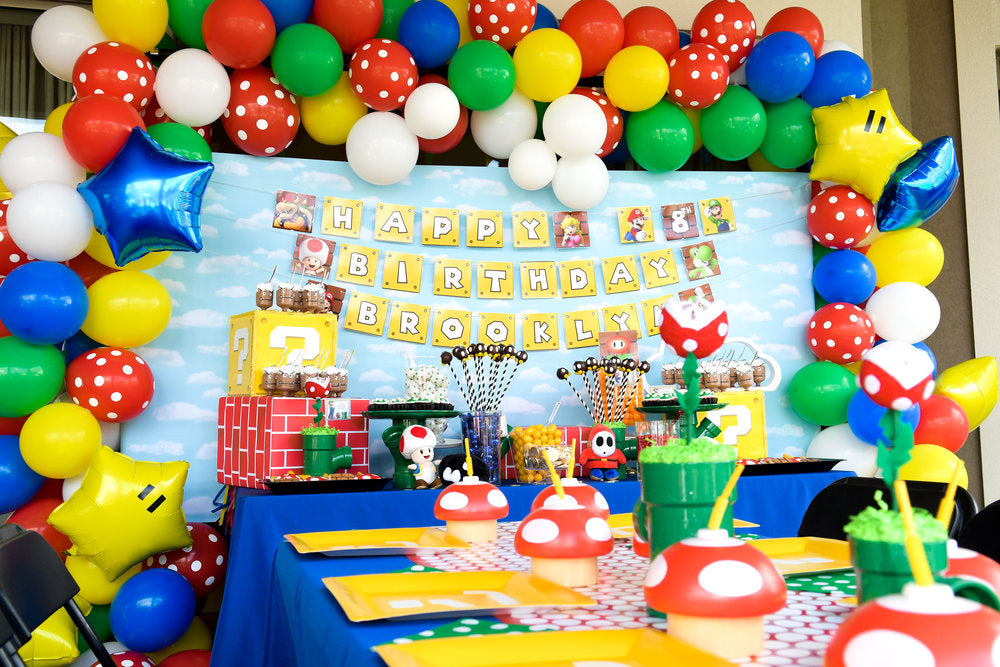 Super Mario Bros themed birthday party wall and tables