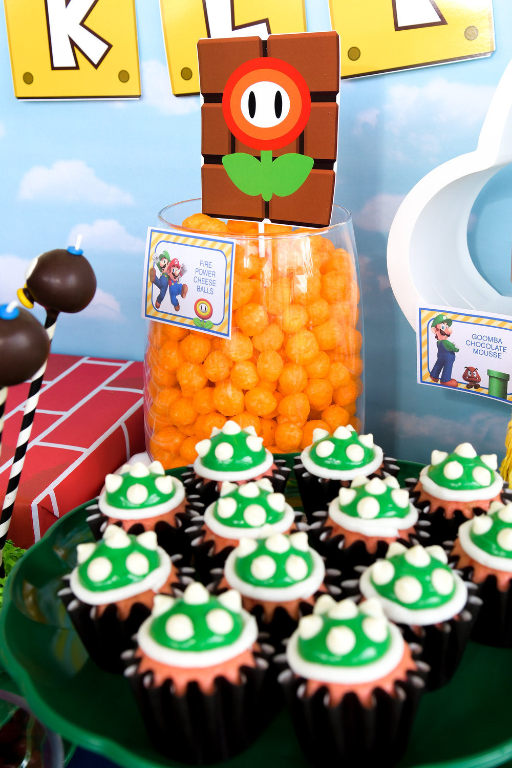 Super Mario Bros themed cupcakes and cheesy puffs