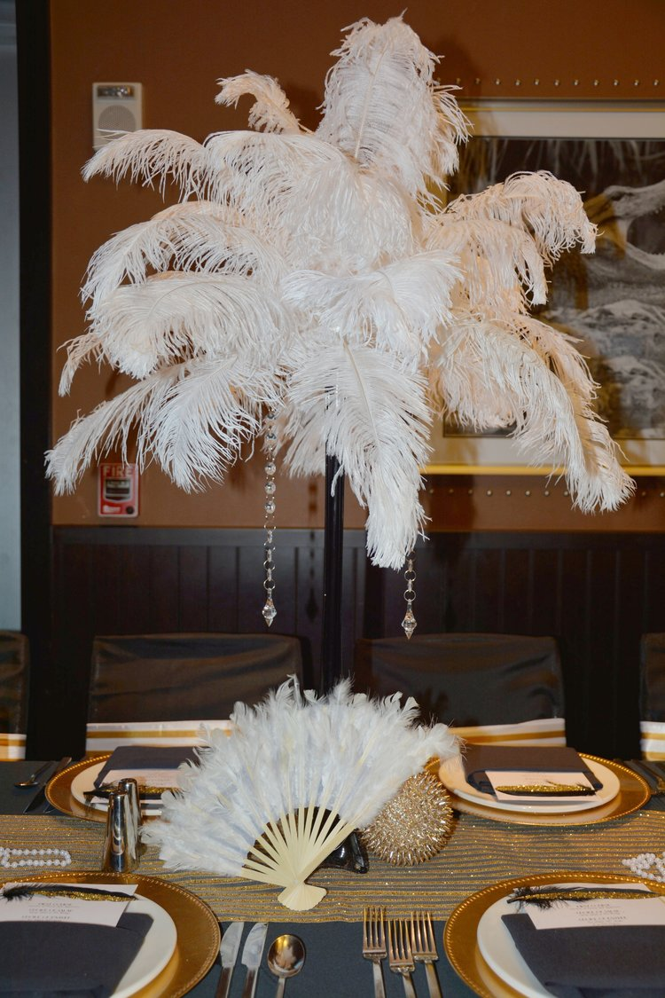 Ostrich feather table centerpiece with various place settings