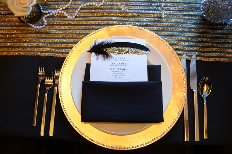 Overhead view of plate and place setting with rehearsal dinner menu