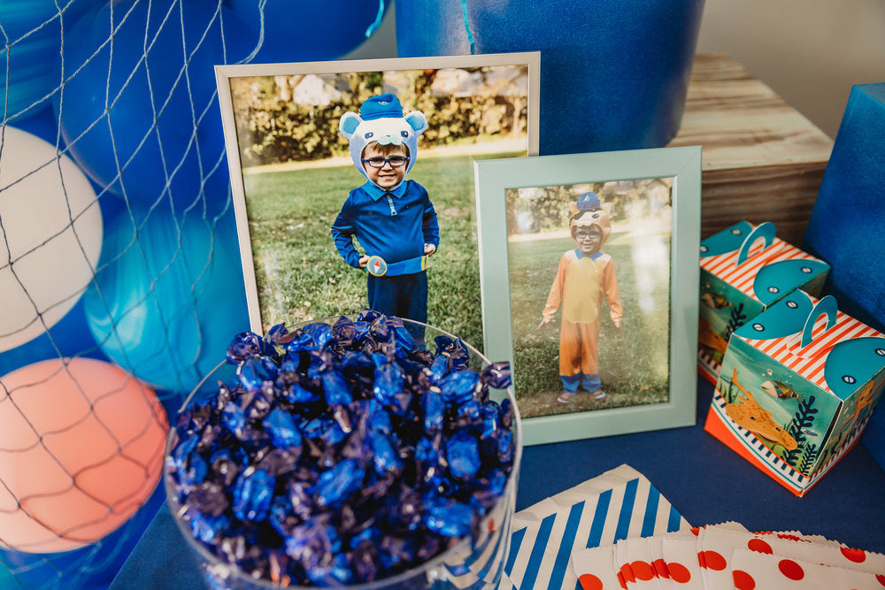Closeup of table decoration with 2 photos of boy