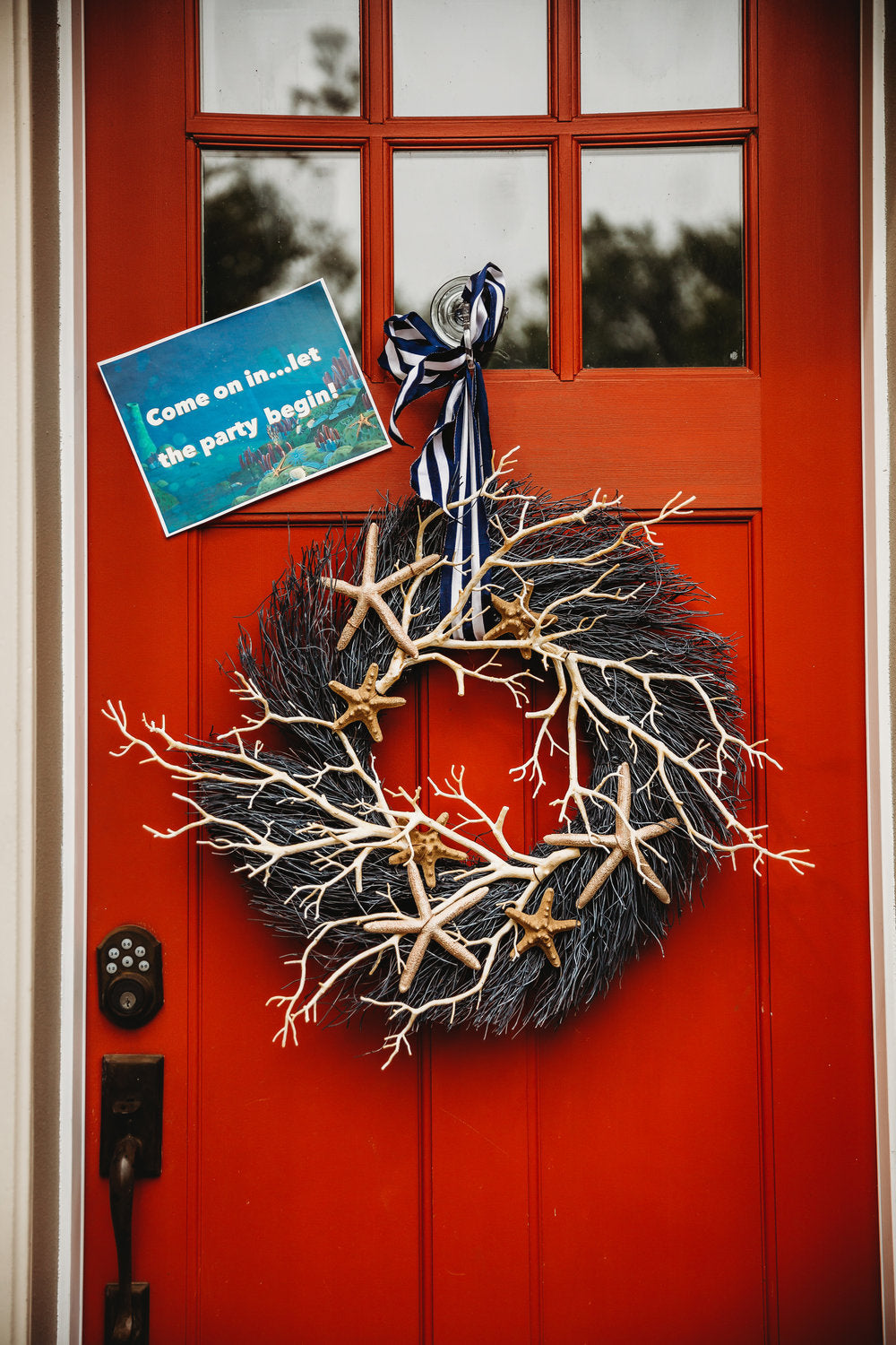 Closeup of front door with ocean themed door wreath