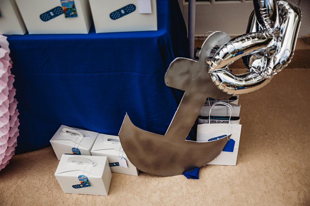 Closeup photo of anchor decoration with party favor boxes