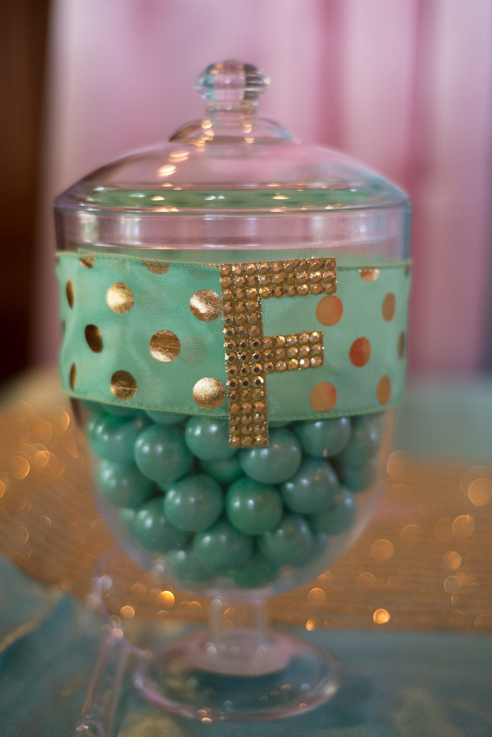Decorated candy jar containing teal candies