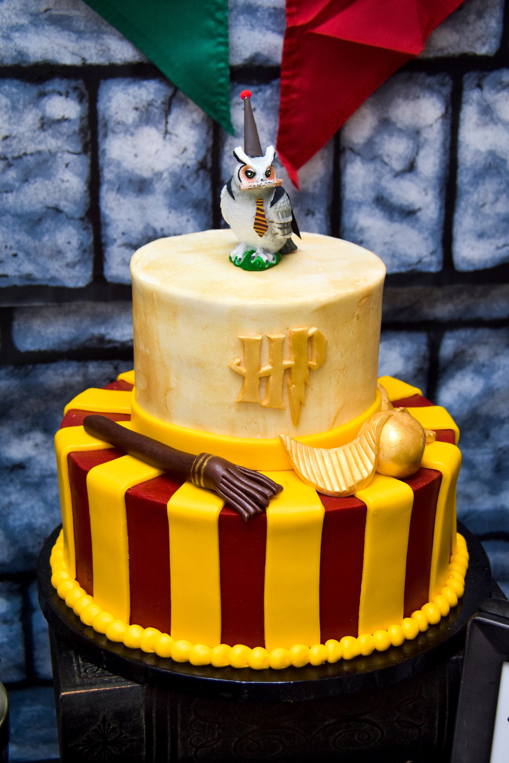 Harry Potter scarlet and gold color Gryffindor birthday cake with owl cake topper