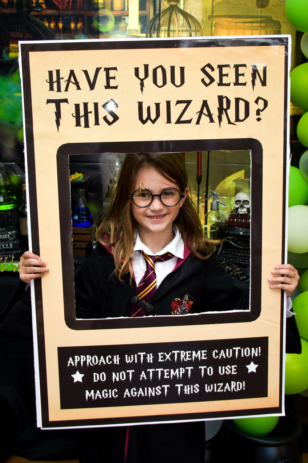 "Birthday girl posing with Harry Potter themed ""Have you seen this wizard"" picture frame"