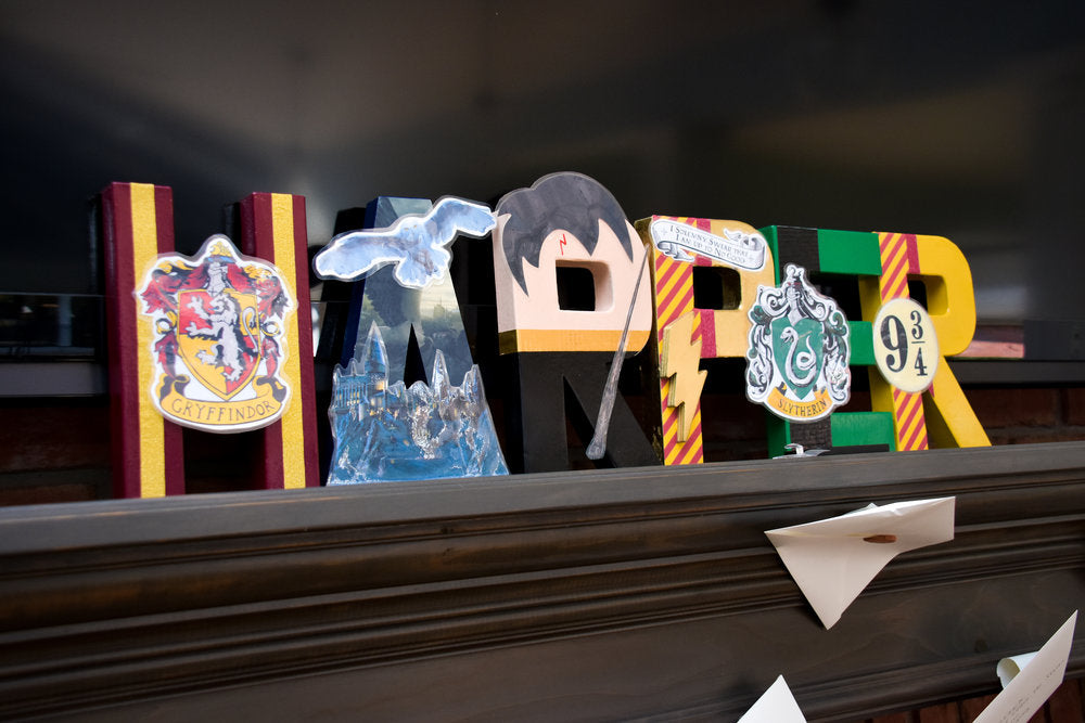 "Closeup of Harry Potter themed letters spelling out ""Harper"""