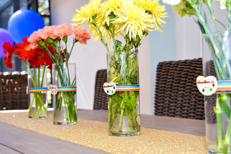 4 flower vases with flowers in different hues