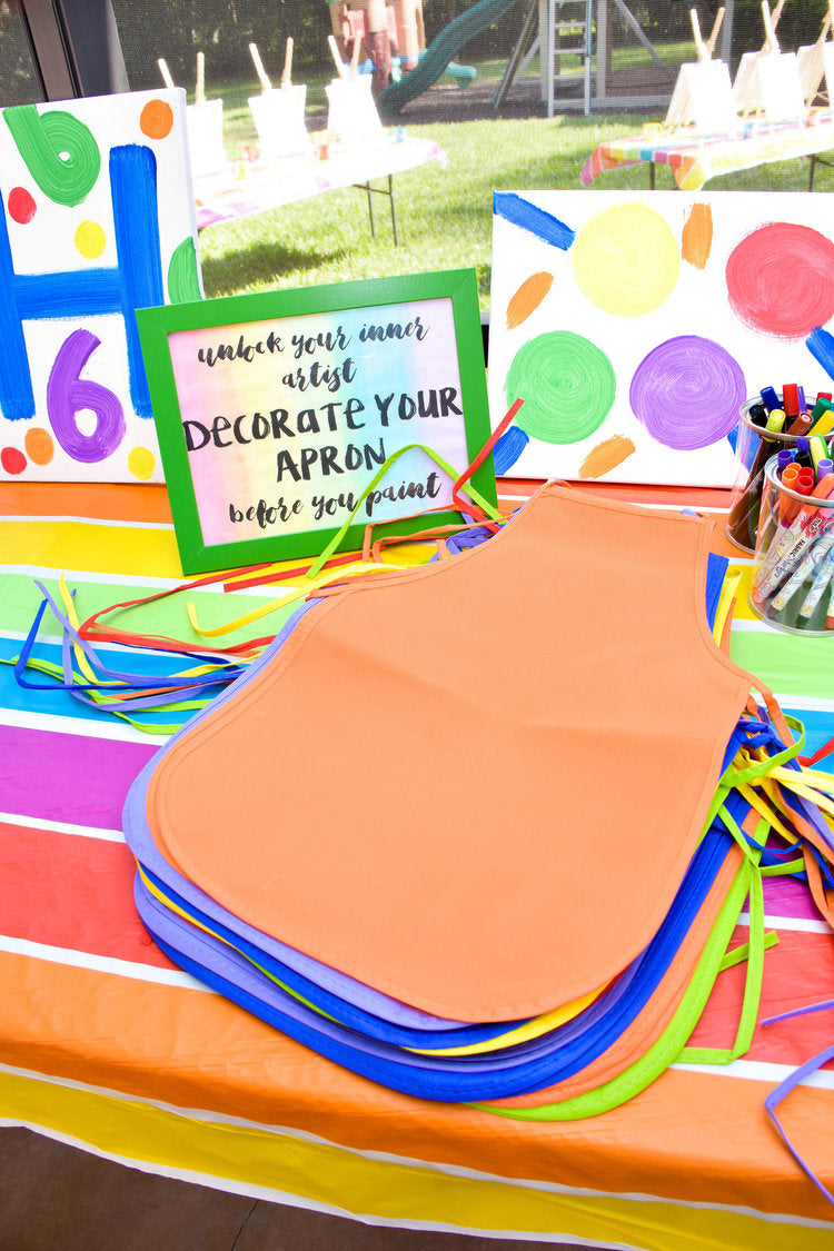"""Decorate an apron"" activity station with colorful aprons and permanent markers in all colors"