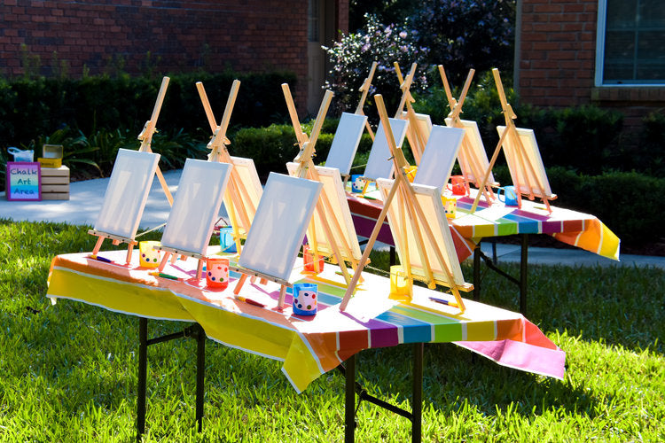 Art activity station with 12 art easels with blank canvases