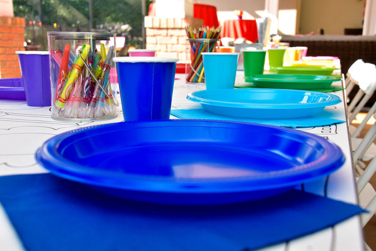 Plastic plates and cups in all the hues of the rainbow