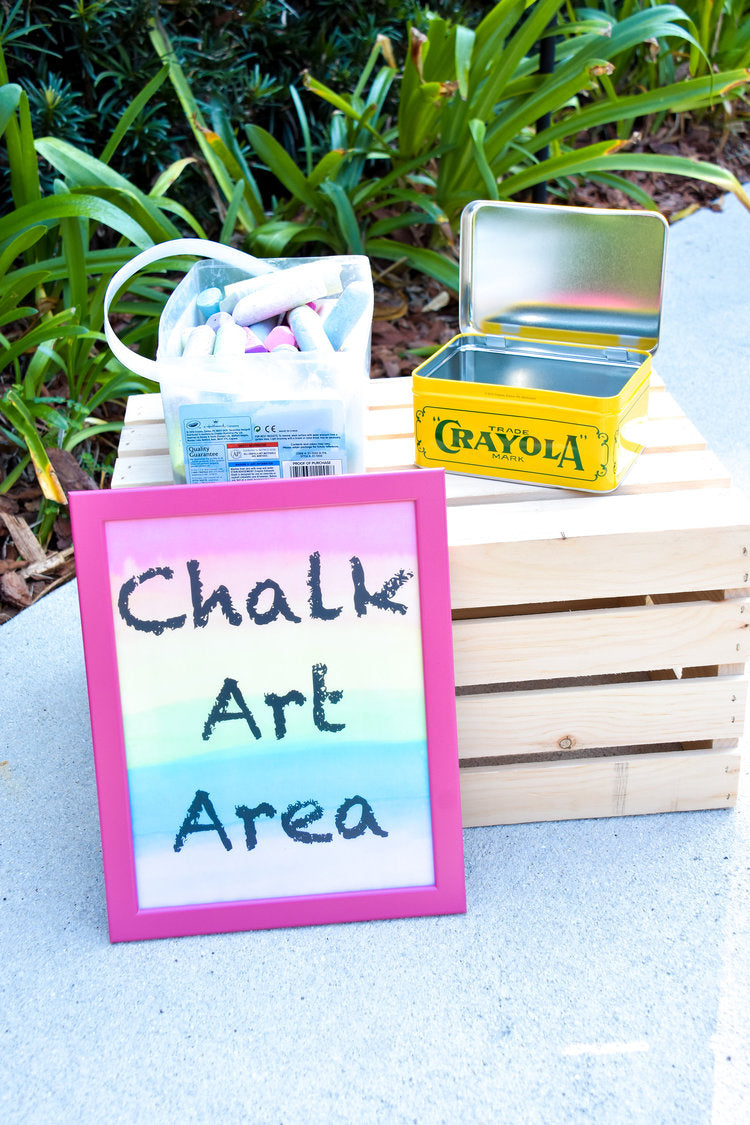 "Plastic tub of chalk in the ""Chalk Art"" activity area"
