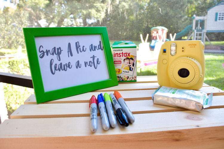 Instant photo activity area with yellow Instax camera and film