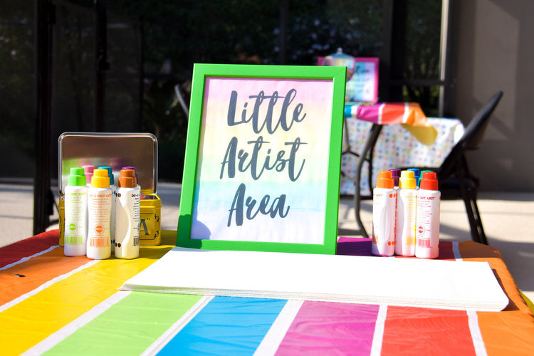 """Little Artist"" activity area with paint pens and paper"