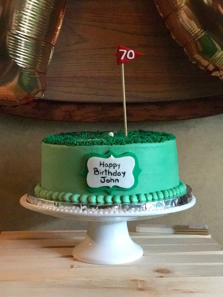 Closeup of a golf green themed birthday cake