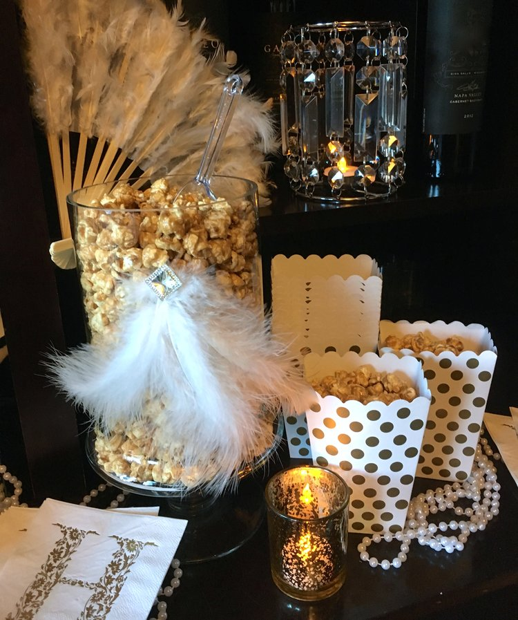 Popcorn bowl and paper buckets decorated in a posh Gatsby theme