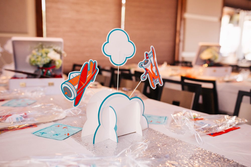 Paper table centerpiece with planes and a cloud