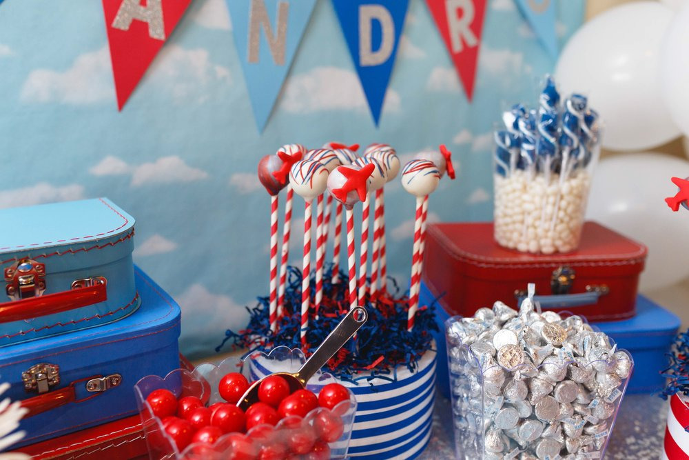 Closeup photo of plane theme cake pops and candy jars