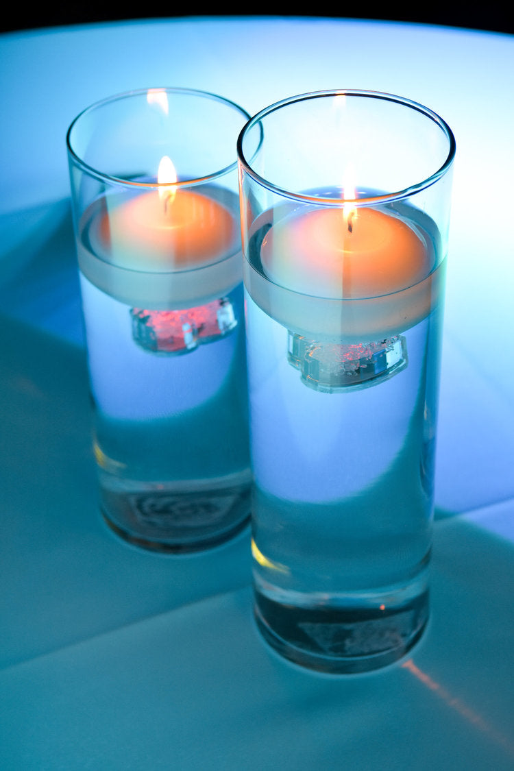 Closeup of floating candles on table