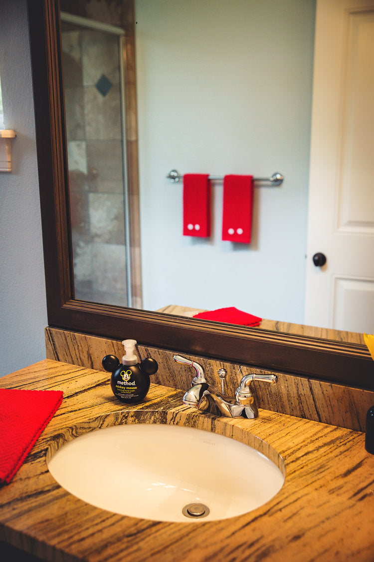 Mickey Mouse themed bathroom with mouse ears soap dispenser