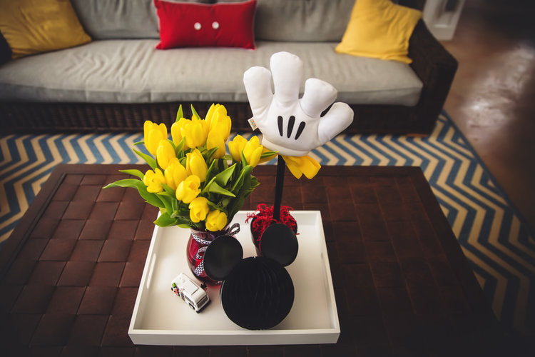 Coffee table decorations with yellow tulips, Mickey Mouse glove and mouse head silhouette