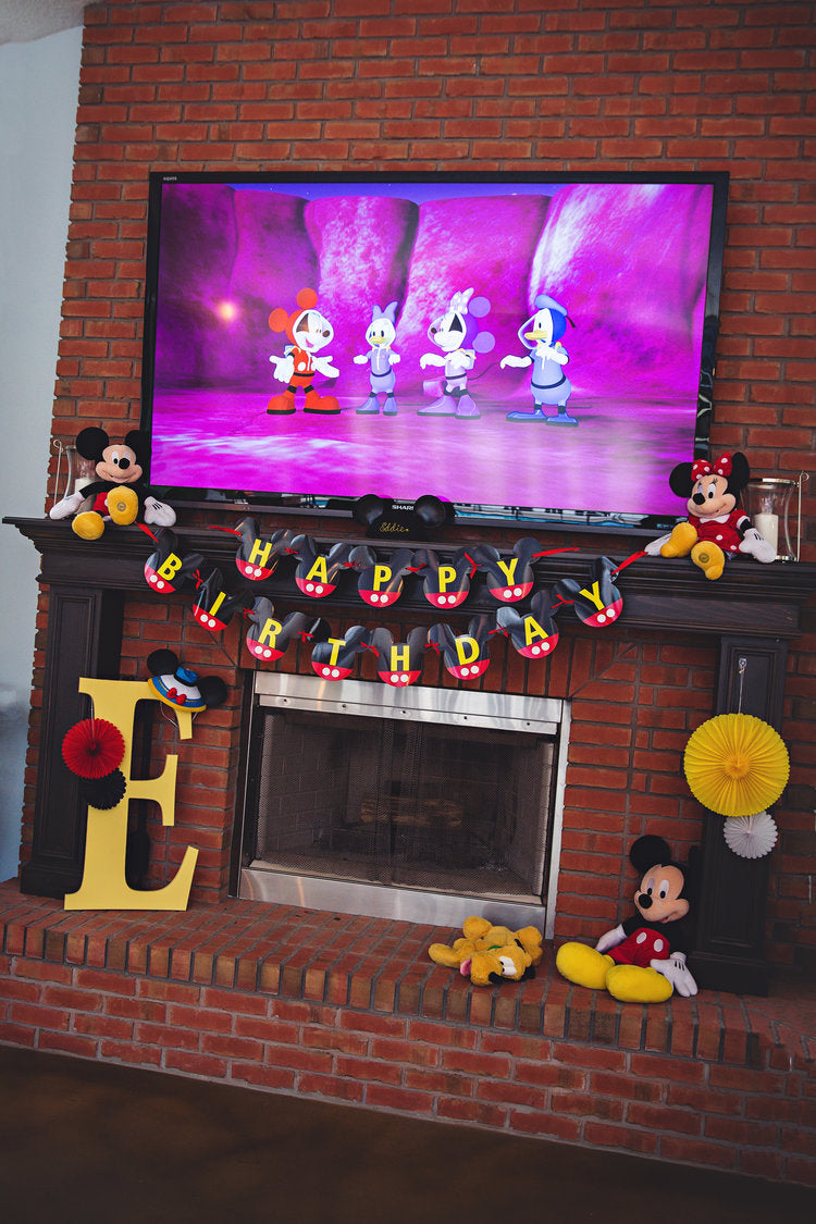 Overall view of fireplace filled with Mickey Mouse decorations