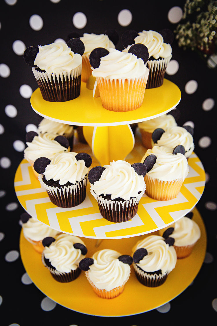 Cupcake stand filled with chocolate and vanilla Mickey decorated cupcakes