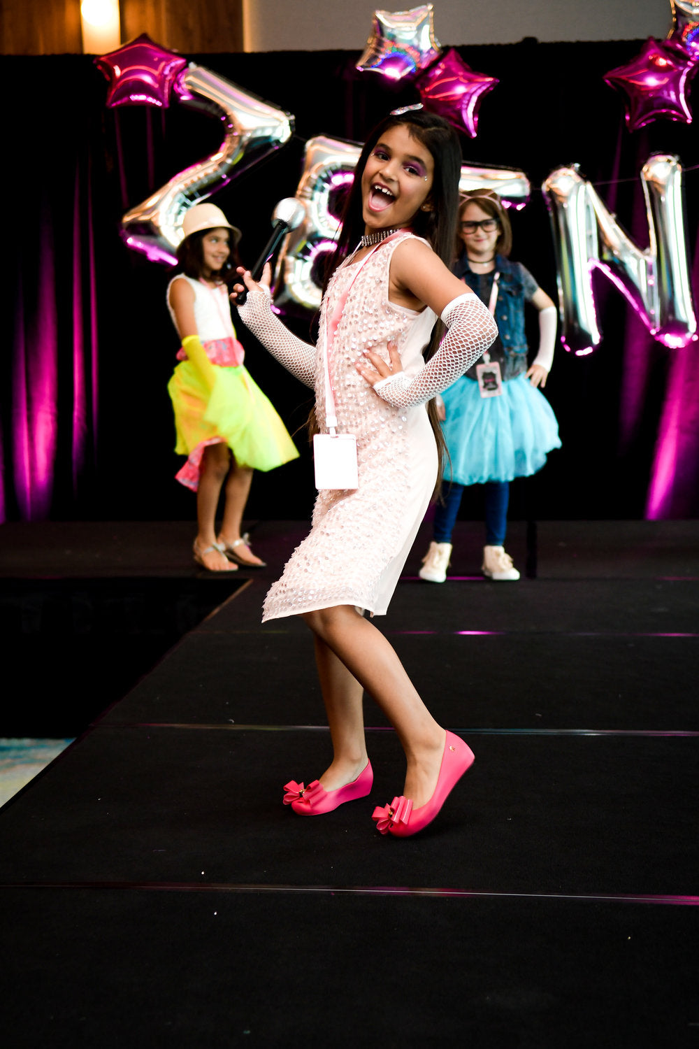 Birthday girl posing on runway for birthday fashion show