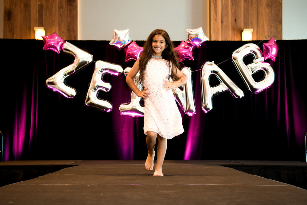 Birthday girl walking down runway for birthday fashion show