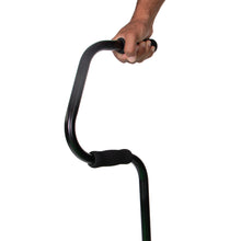 Close Up of Hand Clutching Easy Riser Quad Cane Handle