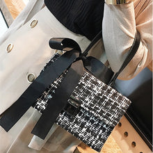 black and white tweed bag sling bag with bow edgability model view