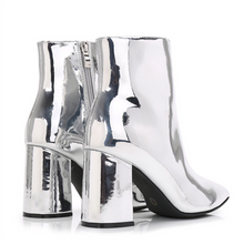 silver booties with block heel edgability angle view