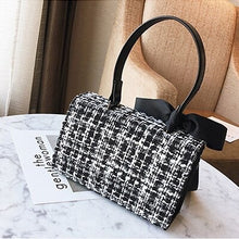 black and white tweed bag sling bag with bow edgability back view