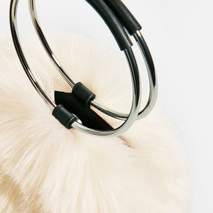 white fur bag with hoop handles edgability detail view