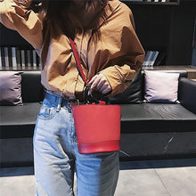 red bag bucket bag minimalist fashion edgability model view