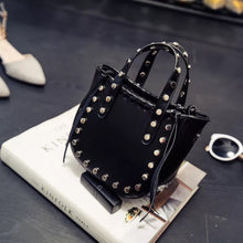 open black bucket bag silver studs angle view edgability