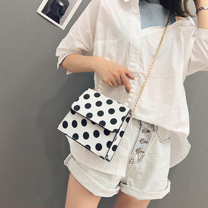 polka dots bag black and white bag pearls bag edgability model view