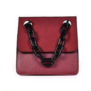 red monotoned bag with black chain straps handle edgability