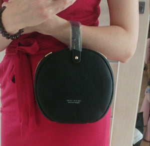 black bag round bag sling bag edgability model view
