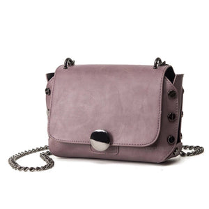 mauve handbag with tiny gunmetal studs edgability