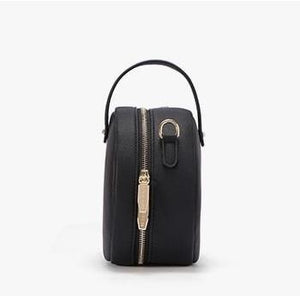 black bag round bag sling bag edgability side view