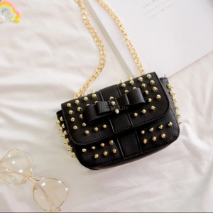 black bag studded bag with gold rivets edgability top view