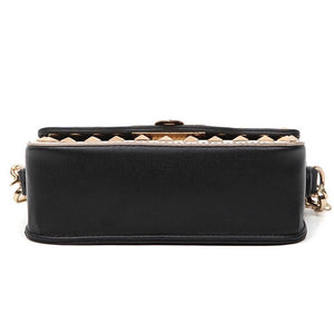 black and beige handbag with gold studs bottom view edgability