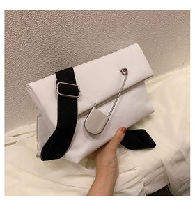 white clutch bag with safety pin edgability size view
