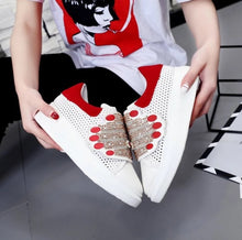 red white sneakers with hands edgability side view
