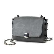 grey handbag with tiny gunmetal studs edgability