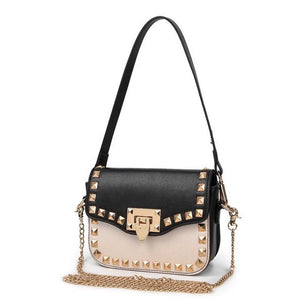 black and beige handbag with gold studs angle view edgability