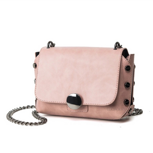 milennial pink handbag with screw studs edgability