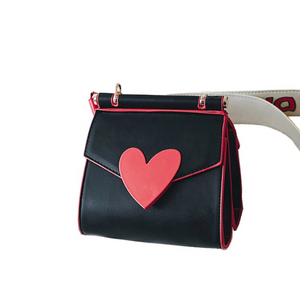 red heart on black shoulder bag with side view edgability